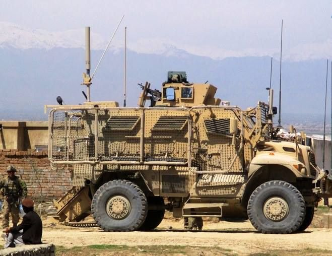 Navistar Defense MaxxPro MRAP vehicle with Rocket Propelled Grenade (RPG) nets at work supporting the White Platoon, Apache Troops in Afghanistan.jpeg