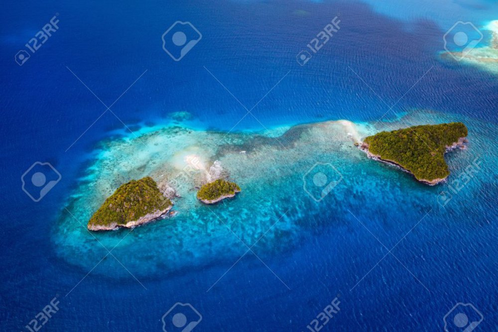 45003741-beautiful-view-of-palau-tropical-islands-and-pacific-ocean-from-above.thumb.jpg.b111bbe38cfa711727f7640ef1e87152.jpg