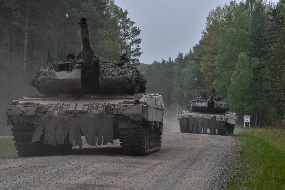 323584135_Polska.Leopard2A5.(4).thumb.jpg.b6aa65e24d46b4807dddc5372cde9df3.jpg