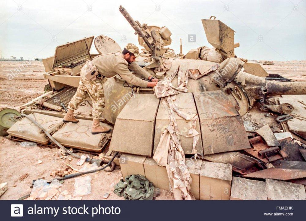 a-qatar-soldier-examines-a-destroyed-iraqi-t-55-battle-tank-during-FMAEHK.thumb.jpg.0060a584174d1fa32788c23acd7e5727.jpg